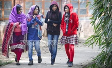 Students of Dhaka University's fine arts department shiver in the biting cold following a shower in the month of Magh. The situation was the same in the entire country on Sunday. Photo: asaduzzaman pramanik/ bdnews24.com