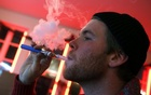 A customer puffs on an e-cigarette at the Henley Vaporium in New York City in this Dec 18, 2013 file photo. Reuters