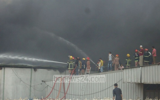 A fire at a thread factory in Gazipur's Konabari on Saturday. Photo: bdnews24.com