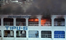 Miscreants set a launch, 'Tipu-6', on fire at Dhaka's Sadarghat during the BNP-sponsored blockade on Saturday. Photo: nayan kumar/ bdnews24.com