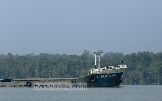 Cargo vessels on Shela river in Sundarbans after ban on traffic following December oil-spill is lifted. Photo taken from the jungle's Chandpai Range recently. Photo: mustafiz mamun/ bdnews24.com