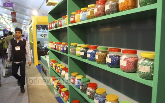Visitors look around the Plastic Fair organised at Bangabandhu International Conference Centre on Wednesday. Photo: bdnews24.com