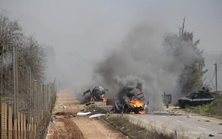 Burning vehicles are seen near the village of Ghajar on Israel's border with Lebanon, January 28, 2015. A Hezbollah missile strike wounded four Israeli soldiers on Wednesday, the biggest attack on Israeli forces by the Lebanese guerrilla group since a 34-day war in 2006. Reuters
