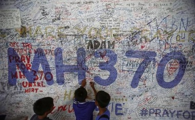 Children write messages of hope for passengers of missing Malaysia Airlines Flight MH370 at Kuala Lumpur International Airport (KLIA) outside Kuala Lumpur June 14, 2014. Credit: Reuters
