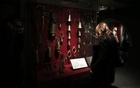 A visitor looks at bells displayed at the Museum of Greek Folk Musical Instruments (MELMOKE) in Athens Feb 15, 2015. Reuters