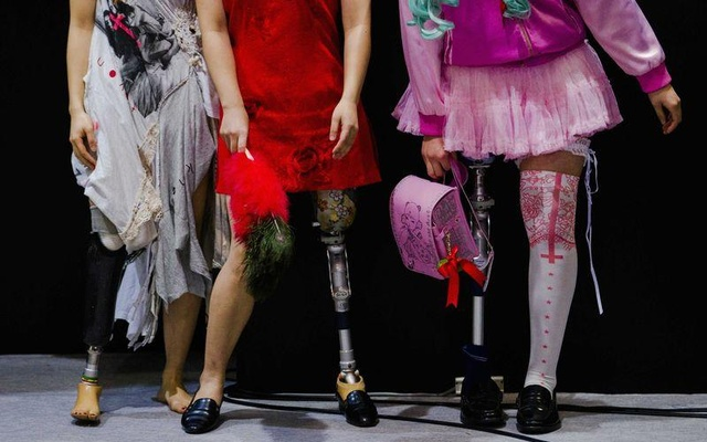 Women wearing prosthetic legs participate in a public photo session at the Hasselblad and Profoto booth, during the CP+ camera and imaging equipment trade fair in Yokohama, Feb 14, 2015. Reuters