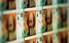 The new 100 French Francs banknotes representing French painter Paul Cezanne is displayed during the bill presentation to the press, December 3.