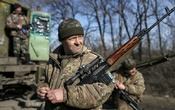 Members of the Ukrainian armed forces are seen near Artemivsk, eastern Ukraine, February 23, 2015. REUTERS