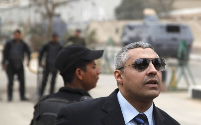 Al Jazeera journalist Mohamed Fahmy is seen outside of a court before a hearing in his trial in Cairo, February 23, 2015. REUTERS