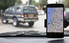 Anagog, an Israeli parking app, is seen on a smartphone in this photo illustration taken in Tel Aviv Feb 18, 2015. Reuters