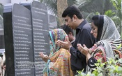 Families mourn the death of army officers, killed during the 2008 BDR mutiny, at Dhaka's Banani Graveyard on Wednesday. Photo: tanvir ahammed/ bdnews24.com