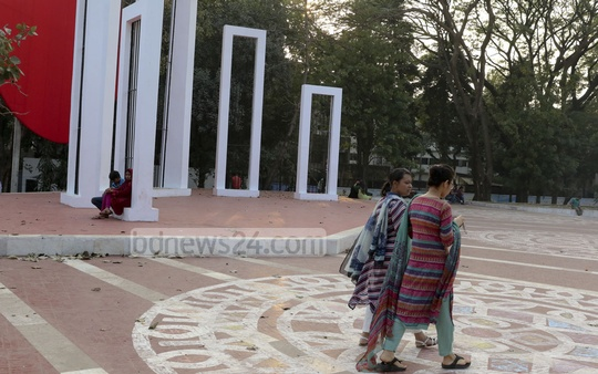 People seen walking at Central Shaheed Minar premises wearing shoes though it's forbidden to do so as it is a memorial for Language Movement martyrs. Photo: mustafiz mamun/ bdnews24.com