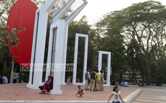 Youths gather at Central Shaheed Minar premises wearing shoes though it's forbidden to do so as it is a monument dedicated to the Language Movement martyrs. Photo: mustafiz mamun/ bdnews24.com