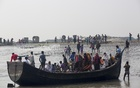 Bangladesh lends land to islanders as water devours homes
