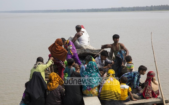 Residents of Nijhum Dwip cross the Moktaria Channel on boats to go to Hatia Upazila. Photo: mustafiz mamun/ bdnews24.com