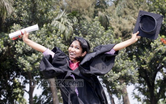 A cheerful graduate takes photos at the Military Museum during the 15th convocation of American International University of Bangladesh on Saturday. Photo: asaduzzaman pramanik/ bdnews24.com
