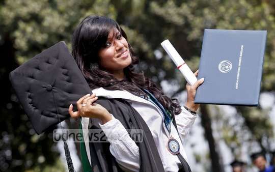 Cheerful graduates take photos at the Military Museum during the 15th convocation of American International University of Bangladesh on Saturday. Photo: asaduzzaman pramanik/ bdnews24.com