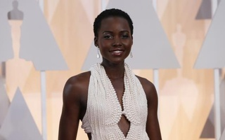 Actress Lupita Nyong'o wears a Calvin Klein gown and Chopard diamonds as she arrives at the 87th Academy Awards in Hollywood, California in this February 22, 2015 Reuters file photo.
