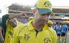 Australia's captain Michael Clarke leads some teammates off the field after losing to New Zealand during their Cricket World Cup match in Auckland, February 28, 2015. Reuters