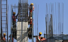 Labourers work at the site of a monorail project in Mumbai February 27, 2015. Reuters