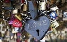 Thousands of padlocks clipped by lovers are seen on the fence of the Pont des Arts over the River Seine in Paris February 13, 2014 on the eve of Valentine's Day. Credit: Reuters