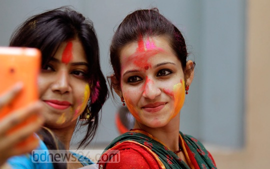 Selfies clicked at Dol (Holi) festival at Dhakeshwari National Temple on Thursday. Photo: bdnews24.com
