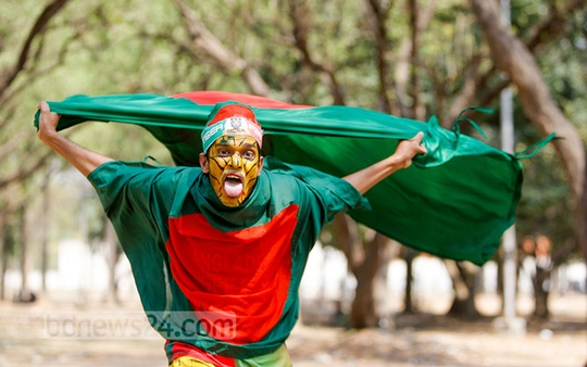 A supporter cheers at Dhaka's TSC area after Bangladesh's stunning victory against Scotland on Thursday in a Cricket World Cup match. Photo: nayan kumar/ bdnews24.com