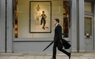 A man passes a gallery in London in this file photo. Reuters