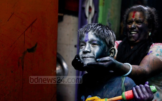 A child is seen playing Holi in Old Dhaka on Friday. Photo: asaduzzaman pramanik/ bdnews24.com