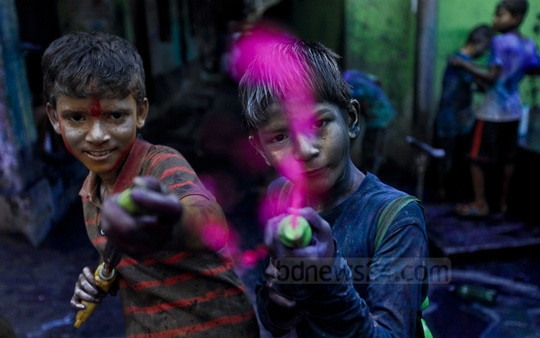 Children are seen playing Holi in Old Dhaka on Friday. Photo: asaduzzaman pramanik/ bdnews24.com