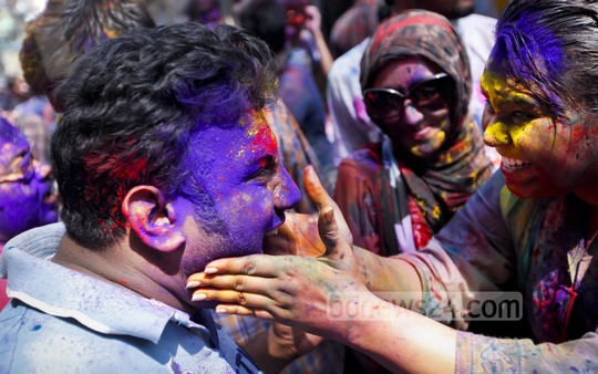Festival of colours, Holi, being celebrated with fun and gaiety at Shakhari Bazar in Old Dhaka on Friday. Photo: asaduzzaman pramanik/ bdnews24.com