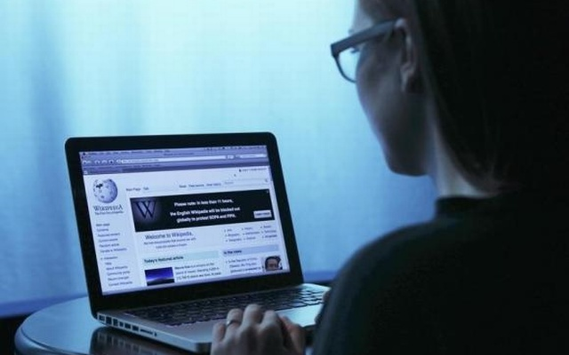 Wikipedia webpage in use on a laptop computer is seen in this photo illustration taken in Washington, Jan 17, 2012. Reuters