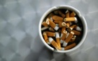An ash tray with cigarette butts is pictured in Hinzenbach, in the Austrian province of Upper Austria, February 5, 2012. Reuters