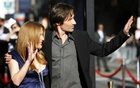 Cast members David Duchovny (R) and Gillian Anderson wave at fans at the movie premiere of 'The X-Files: I Want to Believe' at the Grauman's Chinese theatre in Hollywood, California July 23, 2008. Reuters