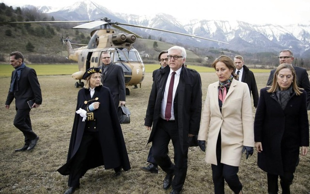 German Foreign Minister Frank-Walter Steinmeier (3R) and French Minister for Ecology, Sustainable Development and Energy, Segolene Royal (2R) walk on a field near the crash site of Germanwings Airbus A320 near Seyne-les-Alpes, March 24, 2015. Reuters