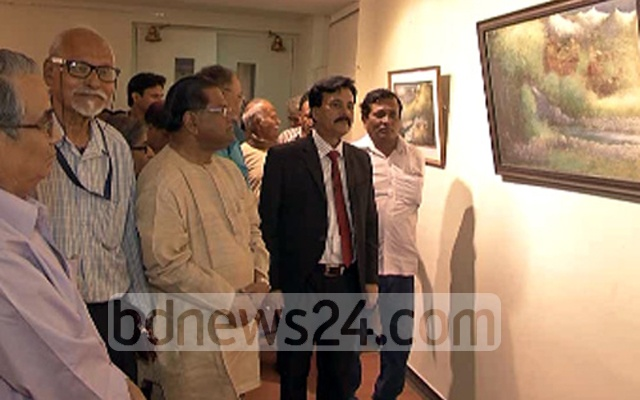 Brahmanbarhia MP Ziaul Haque (2nd from right) looks at a painting at an exhibition in Agartala