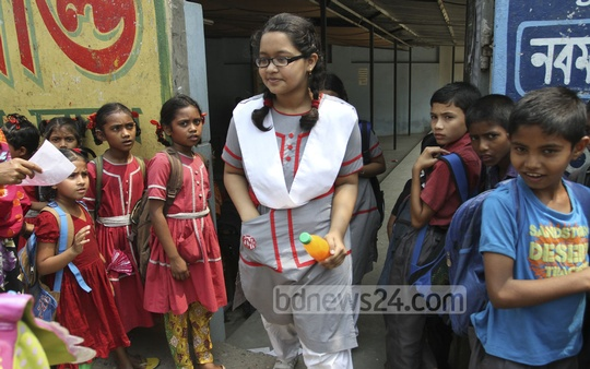 Classes continue in schools and colleges on the weekend to make up for time lost during the BNP-led 20-Party's shutdowns on weekdays. Photograph taken at Holy Cross School on Friday. Photo: nayan kumar/ bdnews24.com