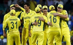 Australian team mates react after they won their Cricket World Cup semi-final match against India in Sydney, March 26, 2015. Reuters
