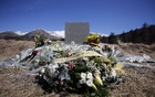 A wreath of flowers to the memory of victims from Spain is seen at the memorial for the victims of the air disaster in the village of Le Vernet, near the crash site of the Airbus A320 in French Alps March 27, 2015. Reuters