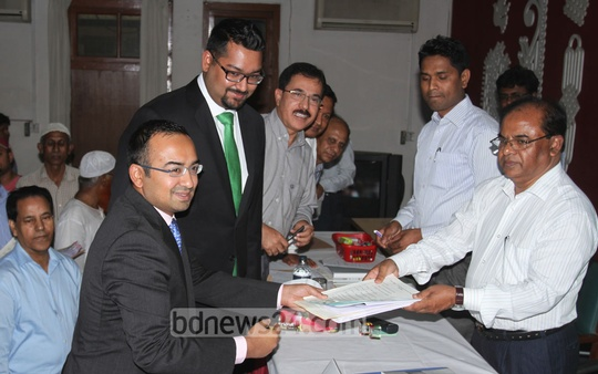 BNP chief's Adviser Abdul Awal Mintoo's nomination papers being filed at the returning officer's office on Sunday by his son Tabith Awal. Mintoo is to contest for mayor of the Dhaka North City Corporation. Photo: tanvir ahammed/ bdnews24.com