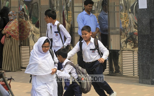 Jovial children are on their way to schools, which returned to regular routine after nearly three months of blockade and shutdowns. Photo taken from Mirpur area on Sunday. Photo: asif mahmud ove/ bdnews24.com