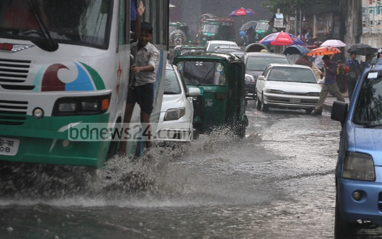 Chittagong's Jamalkhan area submerges under water following a spell of rain on Tuesday. Photo: suman babu/ bdnews24.com
