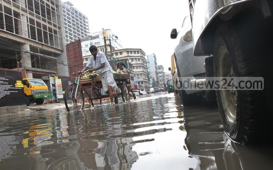 Chittagong's Agrabad area submerges under water following a spell of rain on Tuesday. Photo: suman babu/ bdnews24.com