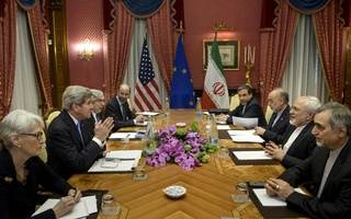 US Under Secretary for Political Affairs Wendy Sherman, Secretary of State John Kerry, Secretary of Energy Ernest Moniz, National Security Council member Robert Malley, Iranian Deputy Foreign Minister Abbas Araghchi, Head of Iran Atomic Energy Organization Ali Akbar Salehi, Foreign Minister Javad Zarif and Special Assistant to Iranian president Hossein Fereydoon, wait to start a meeting at the Beau Rivage Palace Hotel in Lausanne. Photo: Reuters