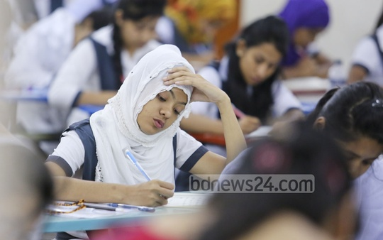HSC and equivalent tests began on Wednesday. An HSC examinee is seen busy writing answers at the viqarunnisa noon school and college centre in Dhaka. Photo: asaduzzaman pramanik/ bdnews24.com