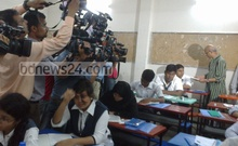 Education Minister Nurul Islam Nahid speaks with an HSC examinee as several others look blankly rattled by the razzle-dazzle of his visit at a test centre in Dhaka.