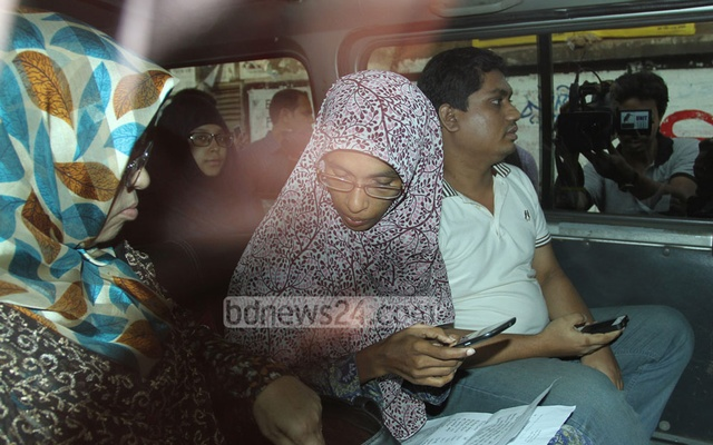 Family members of death-row war crimes convict Jamaat-e-Islami leader Mohammad Kamaruzzaman waiting in front of Dhaka Central Jail to visit him on Saturday. Photo: nayan kumar/ bdnews24.com