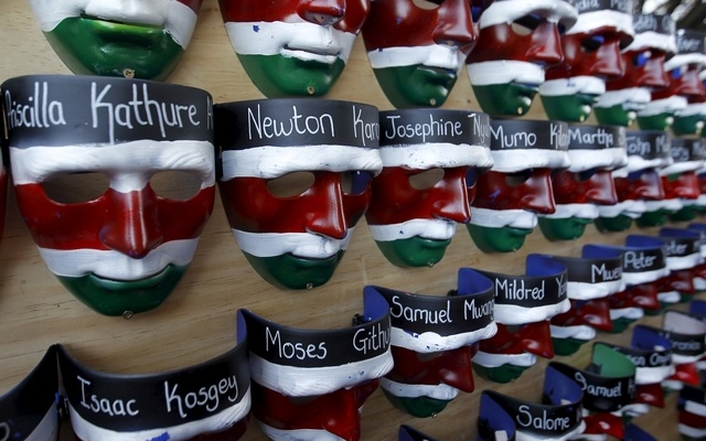 Face masks with names of the Garissa university students who were killed during an attack by gunmen are placed on a wooden board, during a memorial concert at the