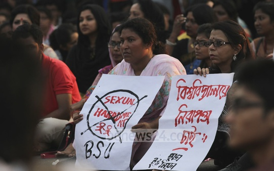 Protestors on Friday hold placards near Dhaka University's Raju Vaskorjo against sexual assault on several women during Bengali New Year celebrations. Photo: tanvir ahammed/ bdnews24.com