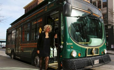 Crystal Hill, a Cleveland regional Transit Authority Trolley driver poses outside her trolley as Tina Turner as part of the Rock and Roll Hall of Fame Induction week in Cleveland. Reuters